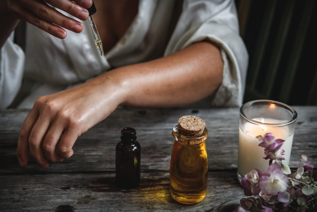essential oils and candle to help connect with senses and get unstuck