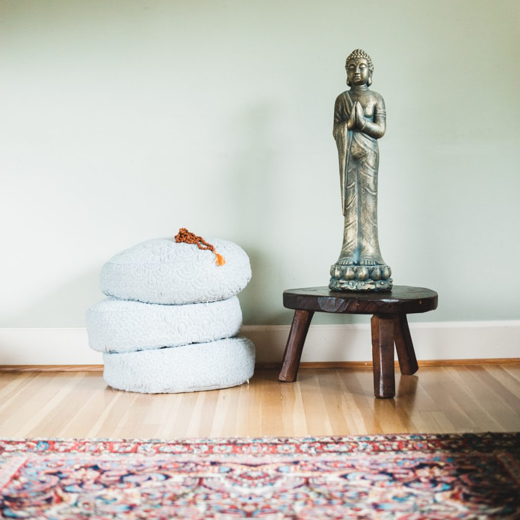 meditating buddha for better sleep care with pillows