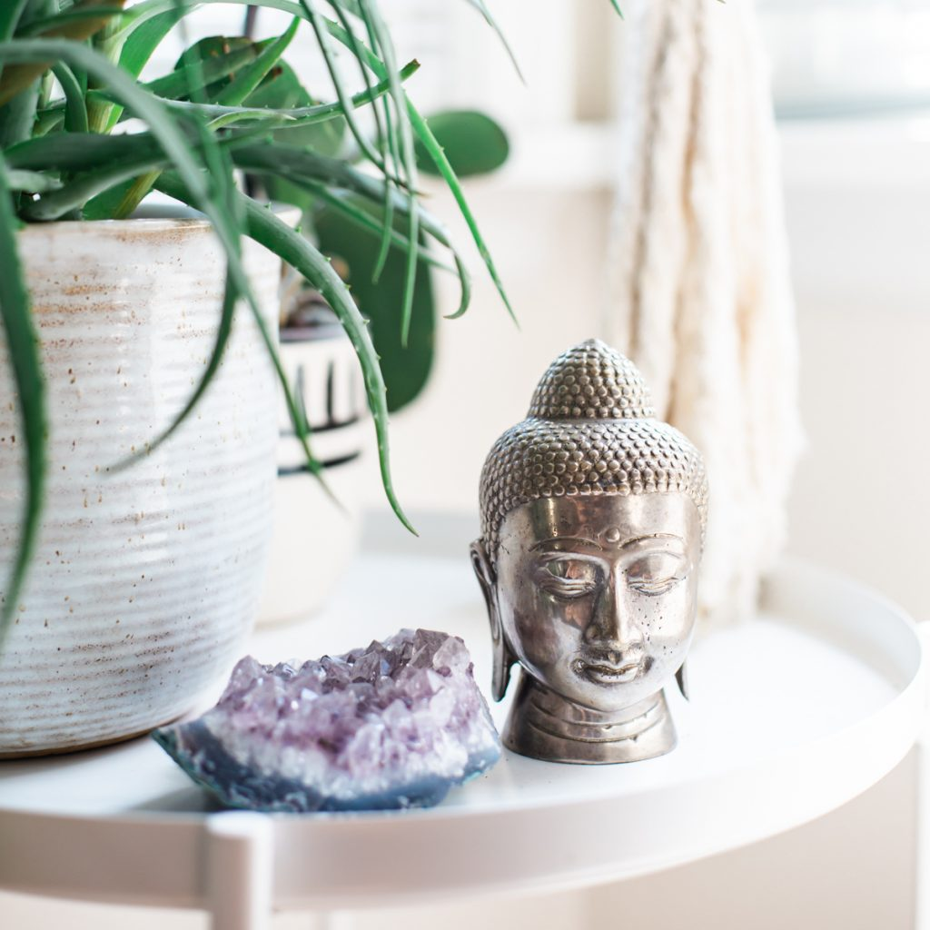 spiritual awakening picture with amethyst crystal and buddha head and green plant