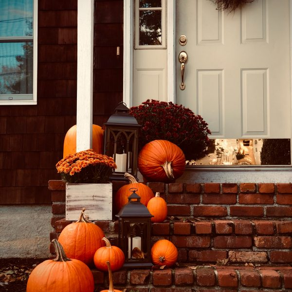 pumpkins on steps of front porch fall hygge vibes